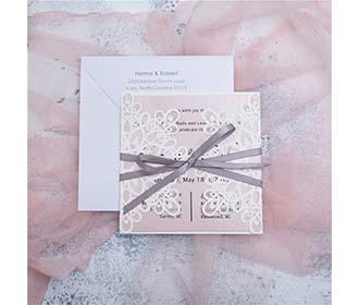 White laser cut wedding invitation with grey ribbon -