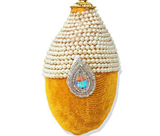 Yellow velvet & pearls decorated coconut -